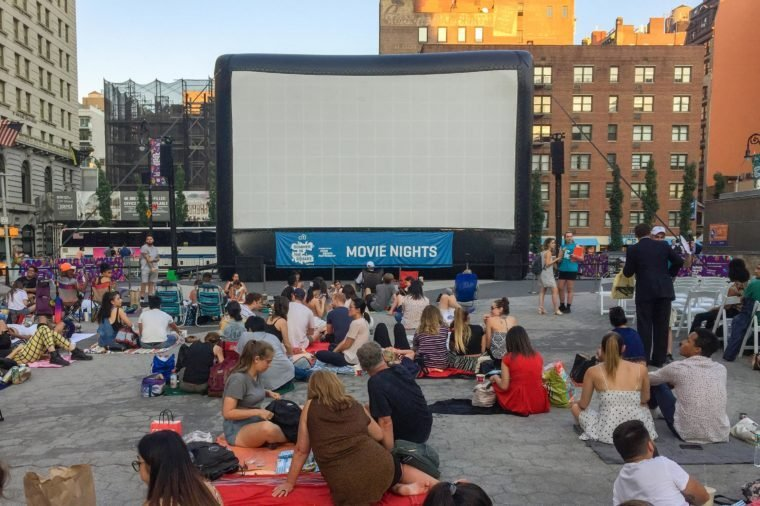 People are waiting to see a movie in Union Square in summer, New York City.