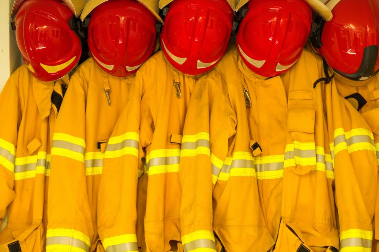 Firefighters in yellow fire-proof uniform