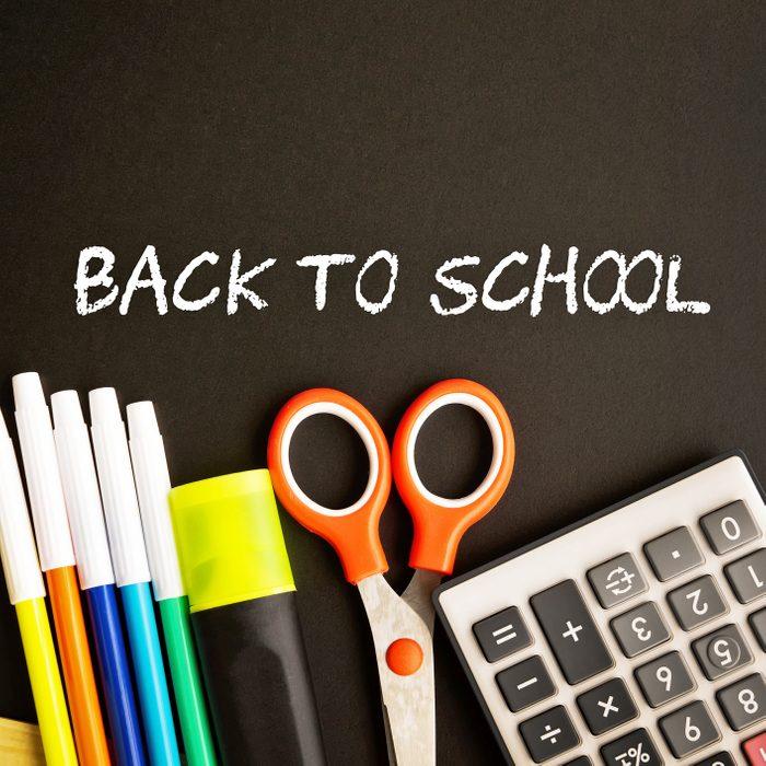 Back To School written on black board with school supplies on sale
