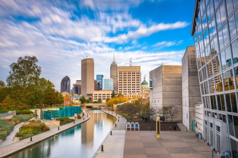 Indianapolis, Indiana, USA downtown skyline over the river walk.