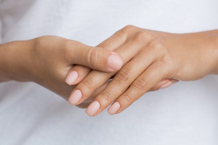 Nude Nails. Woman Showing her Manicure, Holding Hands Together
