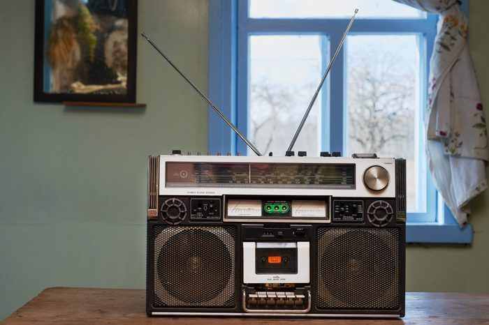 Dusty old radio with one cassette player recorder in rural environment