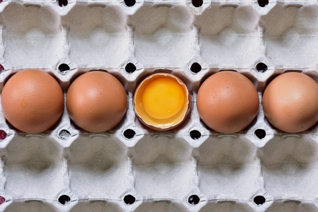 Overhead view Stacking Brown chicken eggs in carton box,Fresh farm eggs with brown eggshell in cardboard packaging Natural healthy food and organic farming concept. Eggs in box