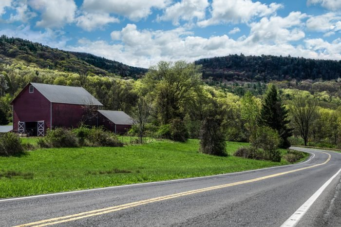 Scenic Drive in New York: Spring colors begin to show along a country road in the Catskill Mountains of southeastern New York.