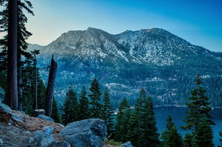 Stunning view of Jakes Peak towering above Emerald Bay at sunset from Inspiration Point scenic overlook, South Lake Tahoe, California