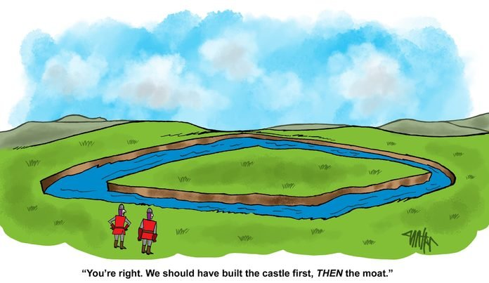 two knights discuss how they should have built the caste first as they stare at a field with a moat creating an island within