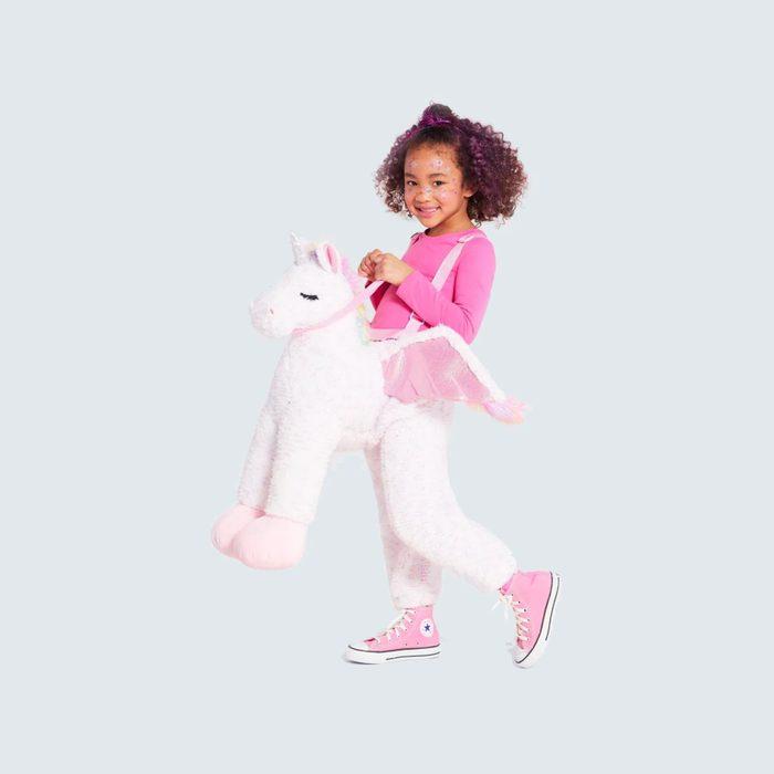 Girl in unicorn costume