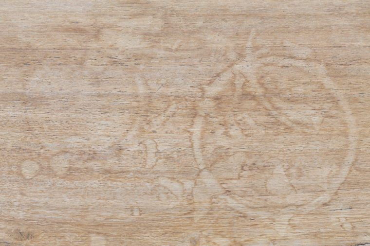 Water marks on a wooden table suitable for use as a background