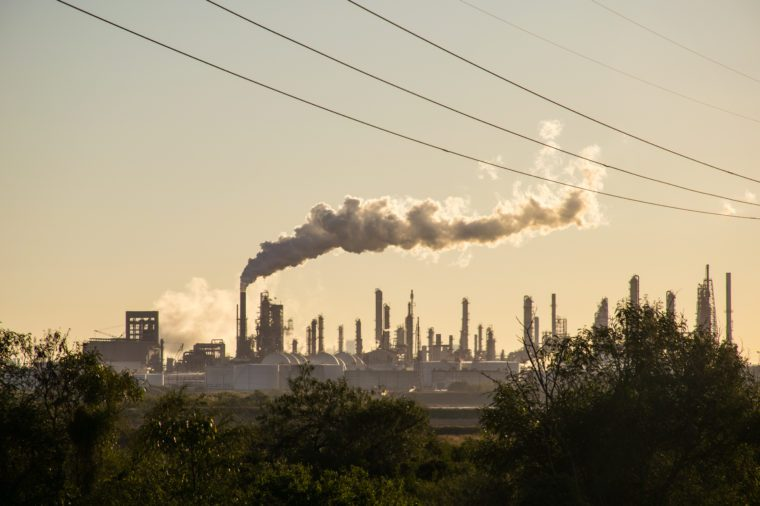 Oil refineries polluting carbon and cancer causing smoke stacks climate change and power plants in Corpus Christi , Texas a massive large refinery