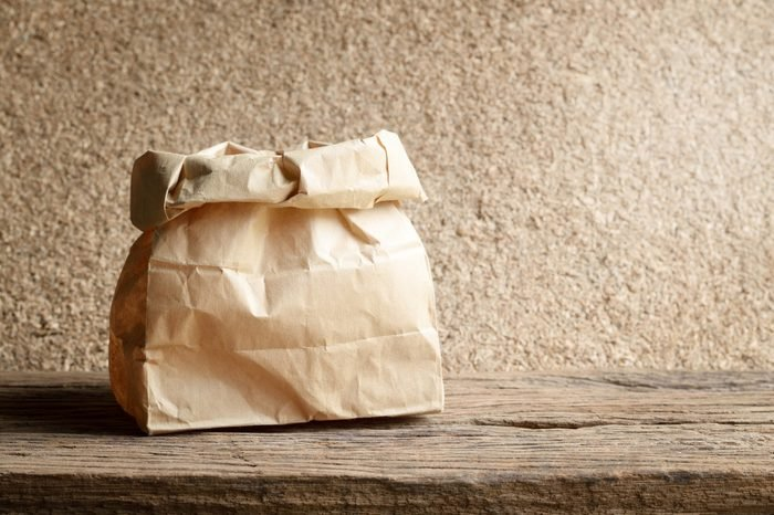 brown paper bag on wooden background