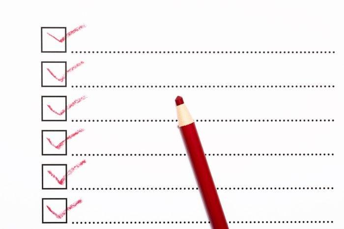 Checklist and red pencil closeup