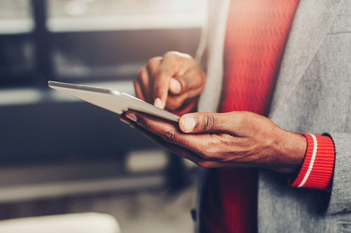 Close up of male hands holding and using tablet. Modern life concept