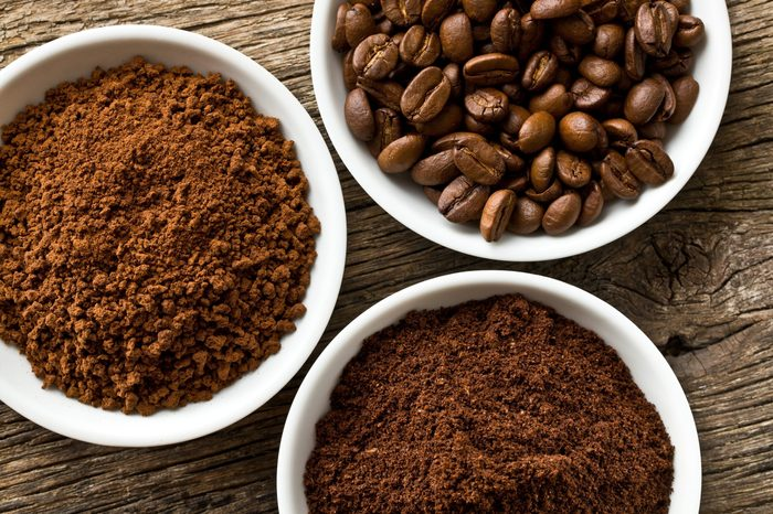 coffee beans, ground coffee and instant coffee in three bowls