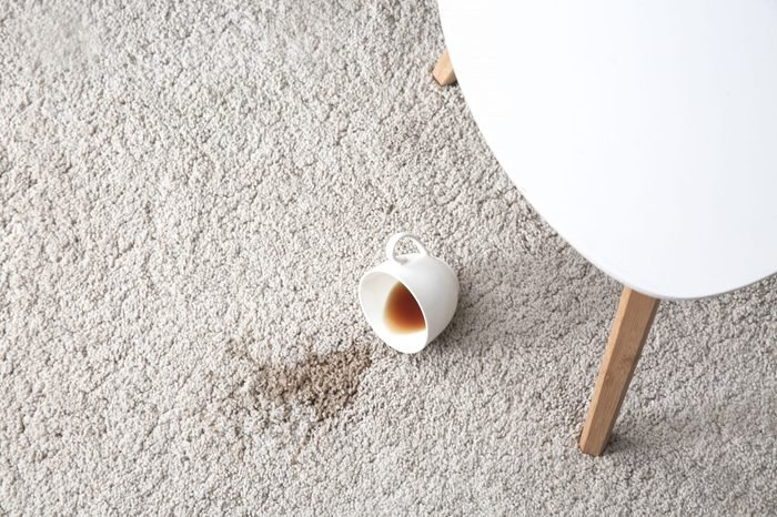 Cup of coffee spilled on carpet