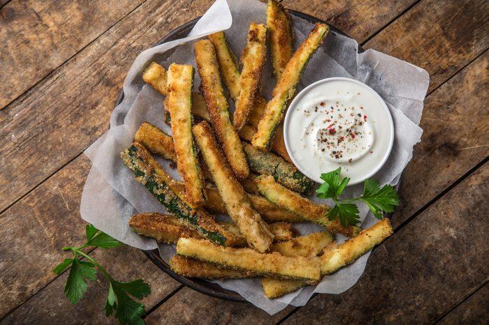 crispy zucchini fries with garlic yogurt sause. top view