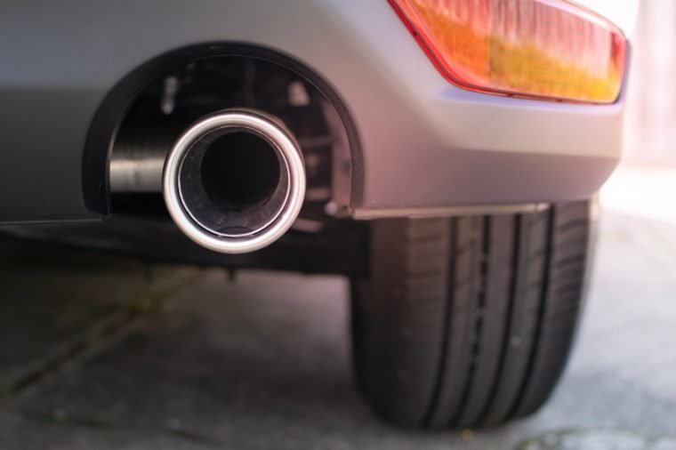 Close up, exhaust pipe of family car