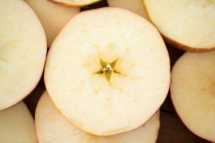 fruits and food concept - close up of apple slices