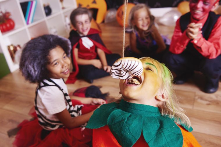 Children enjoying at halloween party