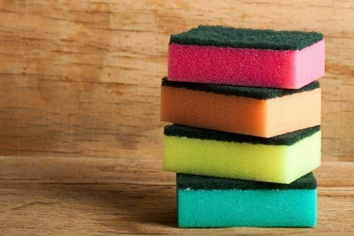 kitchen sponge close up on wood desk