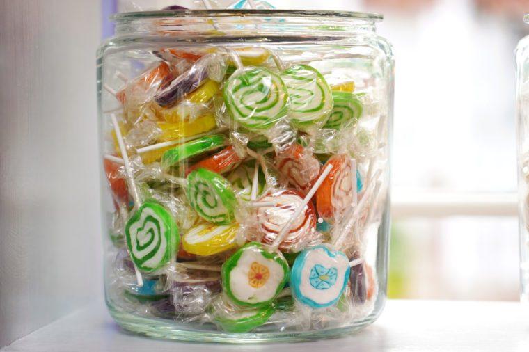 Colorful lollipops in jar