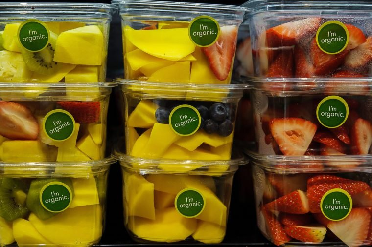 Organic labeled fruit packed for convenience in plastic container