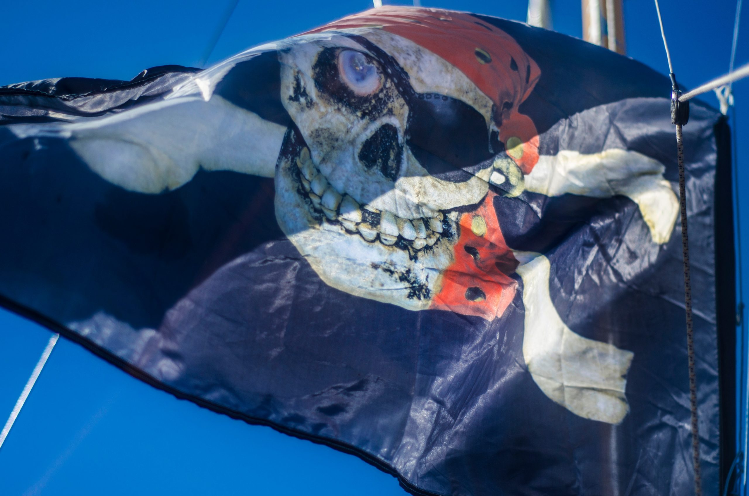 Beautiful pirate flag. Beautiful background and view of the pirate and robber black with bones and skull flag and standard day in summer.