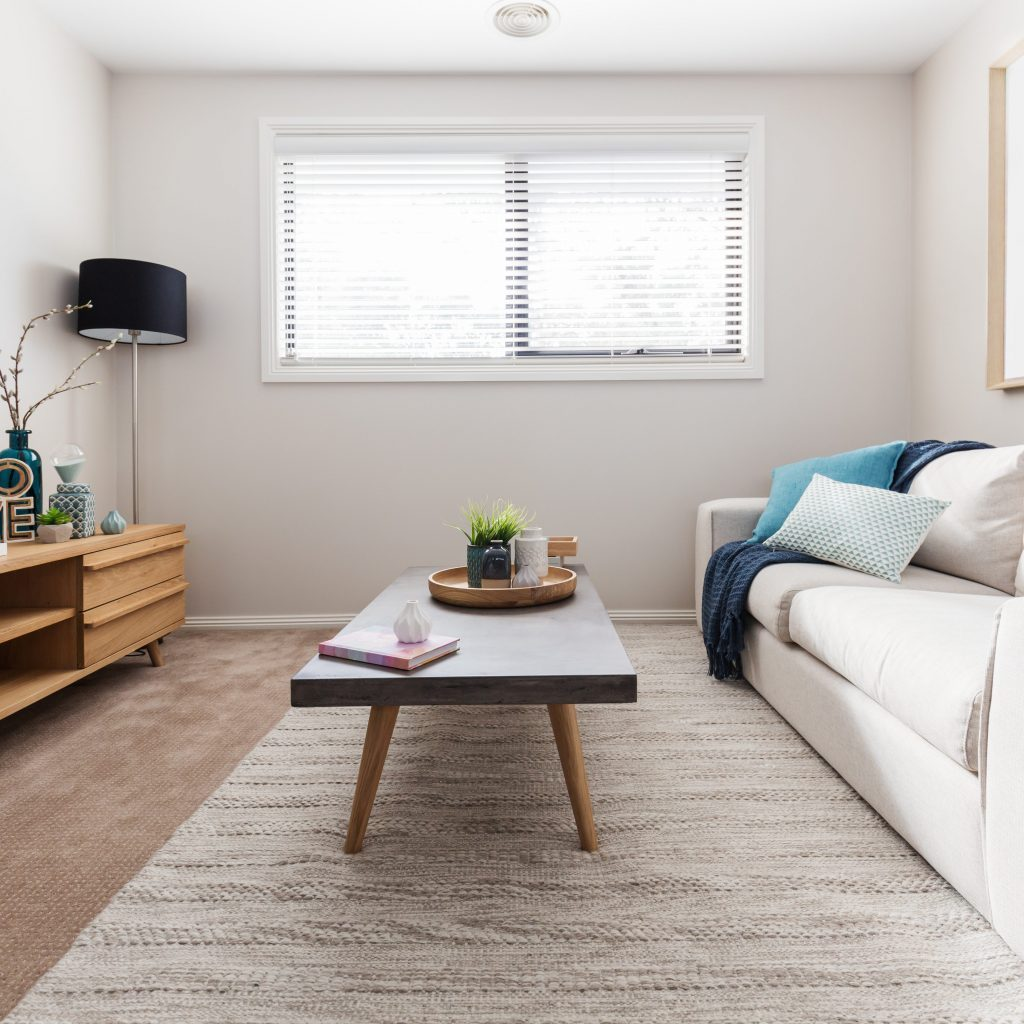 Scandi style living room interior with teal accent cushions
