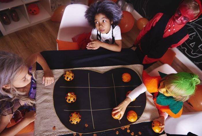 Kids playing halloween tic tac toe