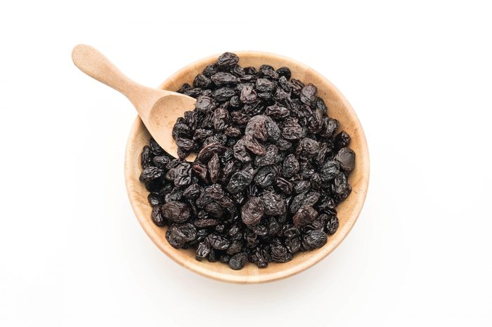 black raisins on white background