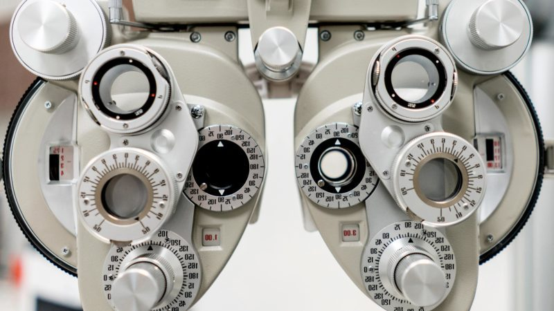 Close-up on a phoropter machine at an optician's practice.
