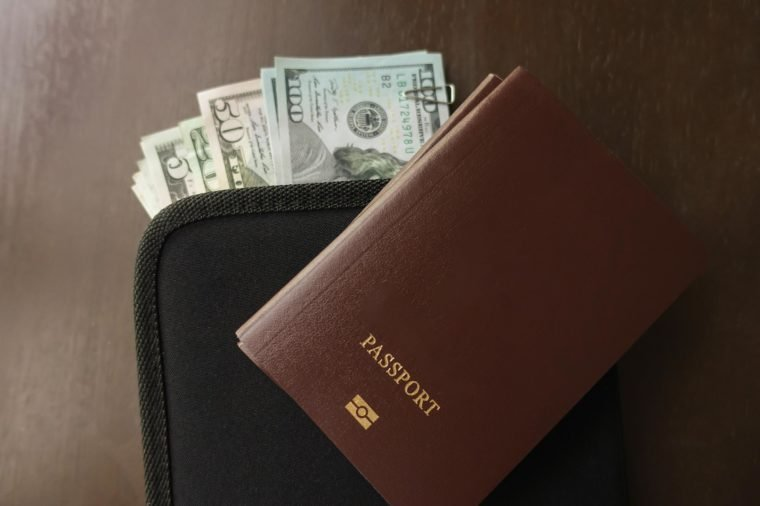 Passport and Money travel plan concept.
