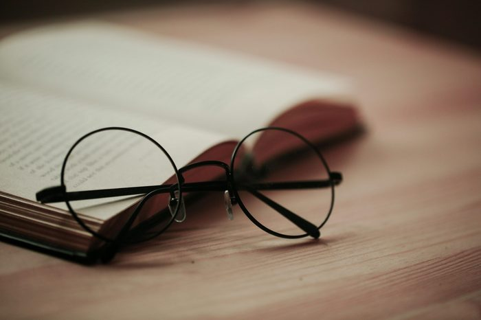 round glasses on book