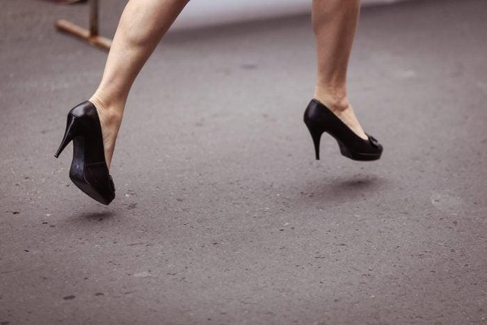 Woman running on high heels