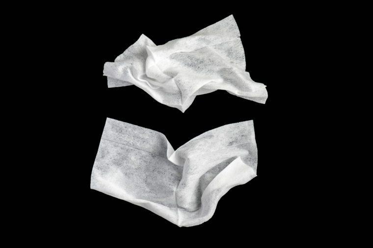 Wet white used napkins isolated on black background