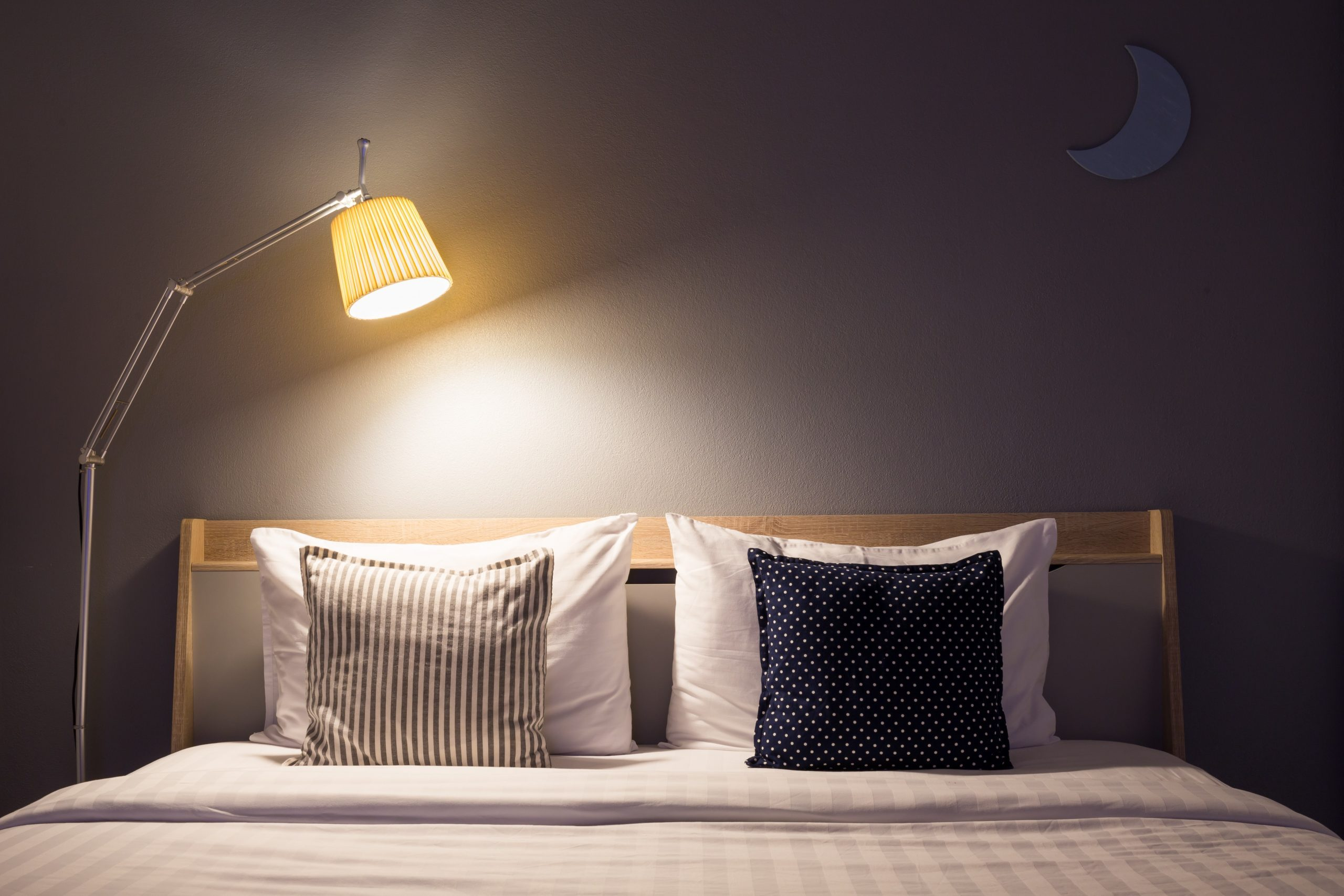 white cute bedroom interior with lamp and wooden in night time.