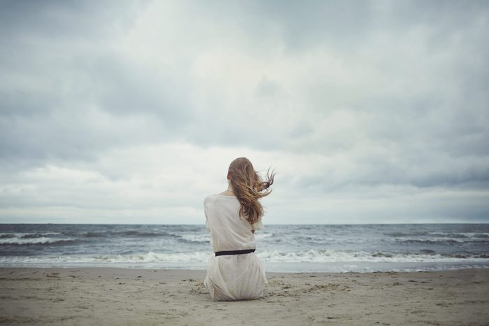 beautiful alone sensual girl on the beach