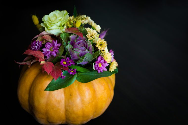 Festive Thanksgiving autumn flowers arrangement in a pumpkin