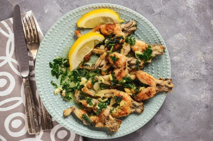 Frog legs baked with garlic butter and parsley.