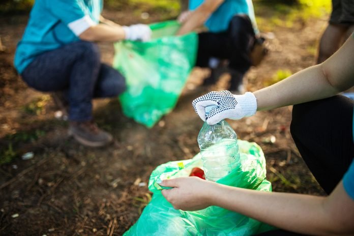 helping the environment by recycling littered plastic