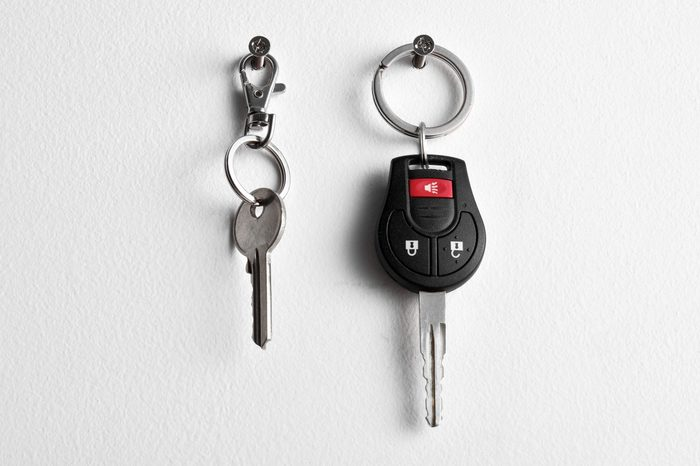 Car and house keys hanging on wall