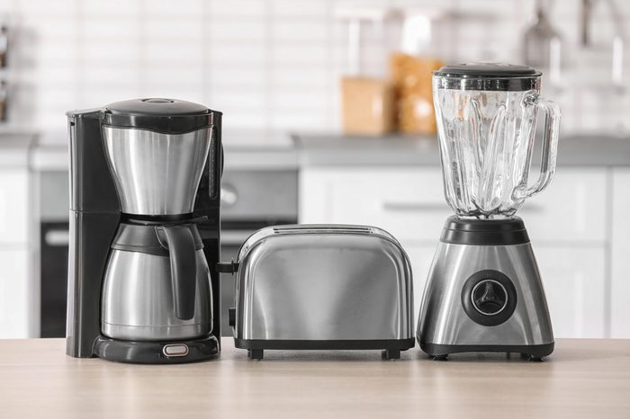 Kitchen appliances on table against blurred background
