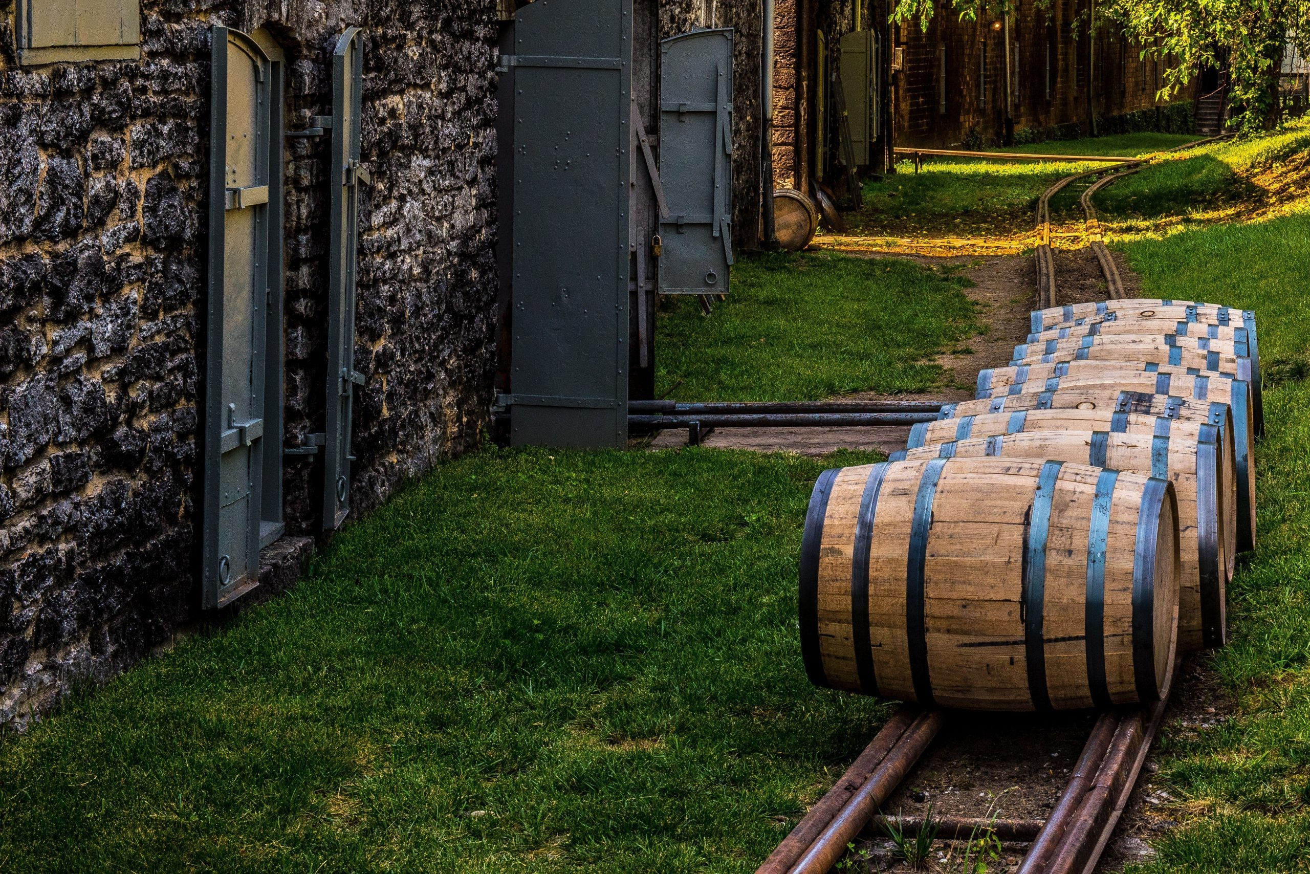 Newly filled bourbon barrels on rail to be transported to warehouse for aging in Kentucky.