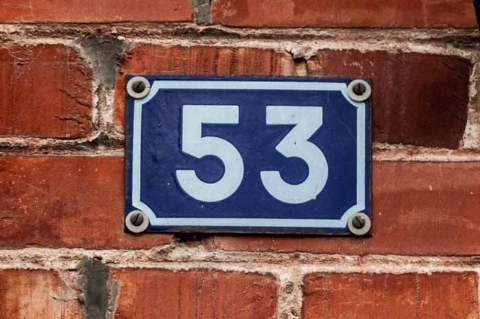House number fifty-three 53 on enamel plaque in white on blue background from France