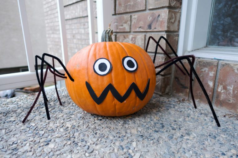 Picture of a spider pumpkin at the front door,made for Halloween.