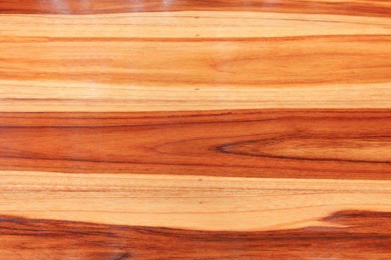 Protective lacquer coating wood surfaces, Paint tin on waxed floor, wooden background - square format