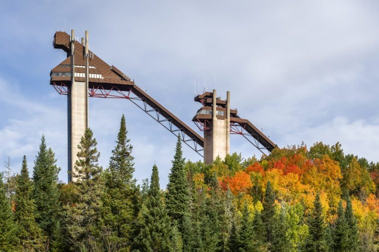 Ski jumps at Lake Placid, NY on a sunny, autumn day with colorful fall foliage