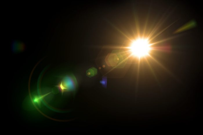 Solar lens flare on black background