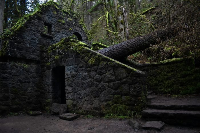 The Witch's Castle in Portland, Oregon is a spooky site of an old abandoned bathroom along a hiking path.