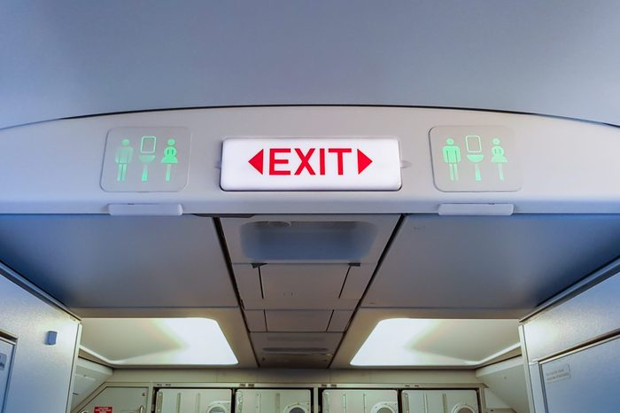 emergency exit sign and toilet sign on airplane