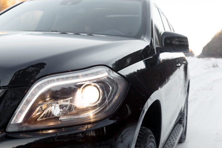 Right headlight by day. Car detail. Car's light. The front lights of the car